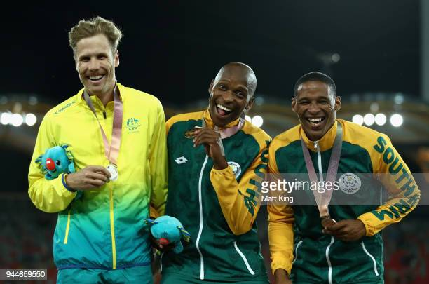 Silver medalist Henry Frayne of Australia, gold medalist Luvo Manyonga of South Africa and bronze medallist Ruswahl Samaai of South Africa pose...