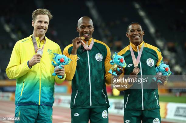 Silver medalist Henry Frayne of Australia gold medalist Luvo Manyonga of South Africa and bronze medallist Ruswahl Samaai of South Africa pose during...
