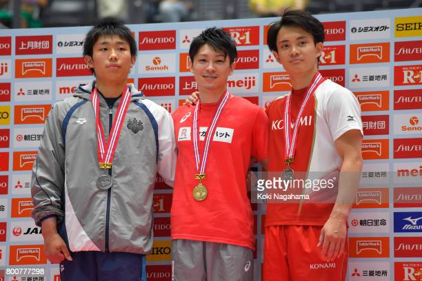 Silver Medalist Hidetaka Miyaji Gold medalist Kohei Uchimura and Bronze medalist Yusuke Tanaka pose for photographs in the award ceremony for the...