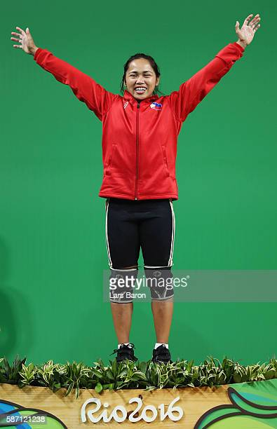 Silver medalist Hidilyn Diaz of the Philippines celebrates on the podium after the Women's 53kg Group A weightlifting contest on Day 2 of the Rio...
