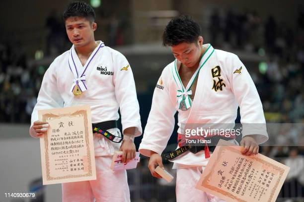 Silver medalist Hifumi Abe and gold medalist Joshiro Maruyama attend a medal ceremony after the Men's 66kg final match during day two of the All...