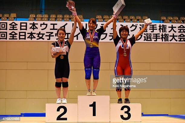 Silver medalist Hiromi Miyake and Gold medalist Kanae Yagi and Bronze medalist Misaki Gushiken pose on the podium after winning in women's 53kg group...