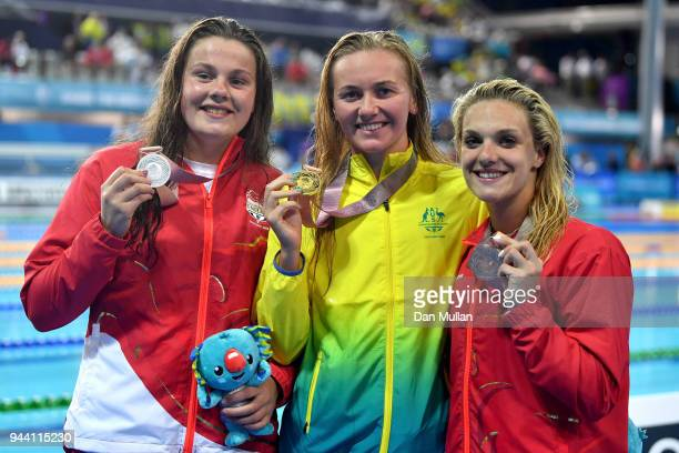 Silver medalist Holly Hibbott of England gold medalist Ariarne Titmus of Australia and bronze medalist Eleanor Faulkner of England pose during the...