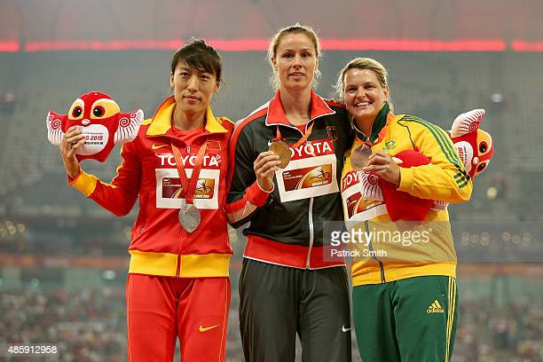 Silver medalist Huihui Lyu of China gold medalist Kathrina Molitor of Germany and bronze medalist Sunette Viljoen of South Africa pose on the podium...