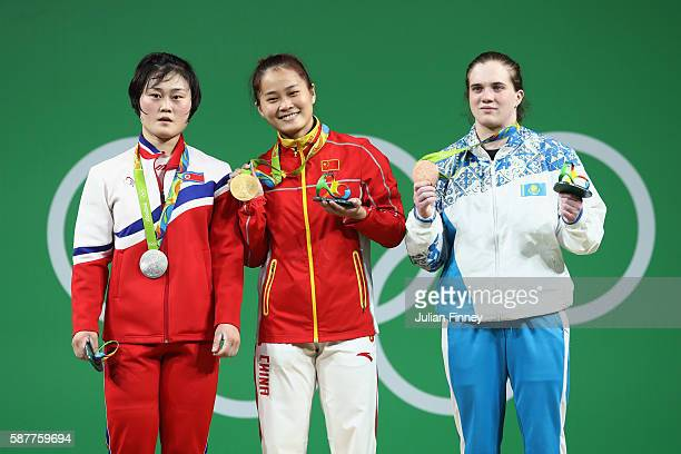 Silver medalist Hyo Sim Choe of Republic of Korea gold medalist Wei Deng of China and bronze medalist Karina Goricheva of Kazakhstan pose on the...