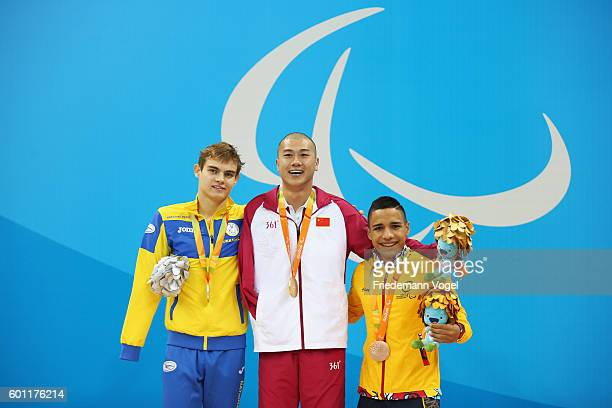 Silver medalist Ievgenii Bogodaiko of Ukraine Gold medalist Pan Shiyun of China and Bronze medalist Carlos Serrano Zarate of Colombia pose on the...