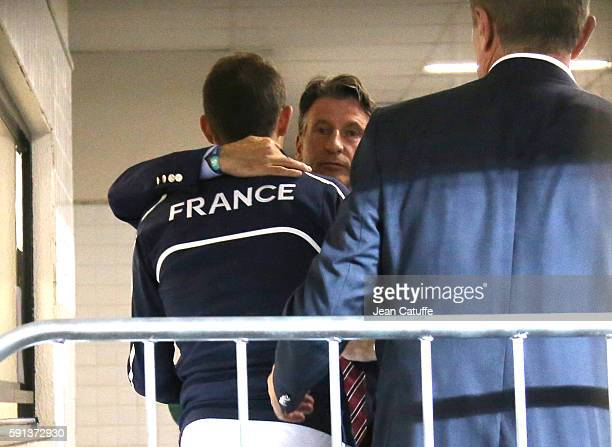 Silver medalist in Pole Vault Renaud Lavillenie of France is consoled by IAAF President Sebastian Coe and Sergey Bubka following the medal ceremony...