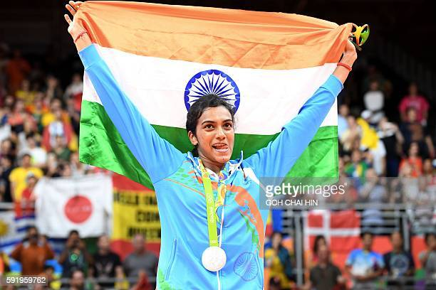Silver medalist India's Pusarla V. Sindhu celebrates on the podium following the women's singles Gold Medal badminton match at the Riocentro stadium...