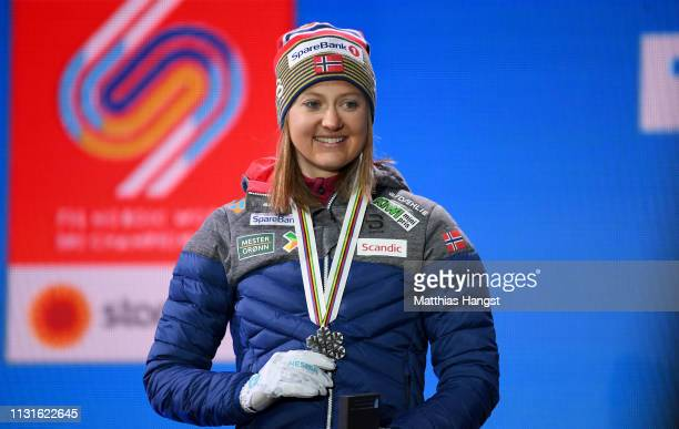 Silver medalist Ingvild Flugstad Oestberg of Norway celebrates with her medal during the medal ceremony for the Cross Country Skiathlon Ladies 15k...