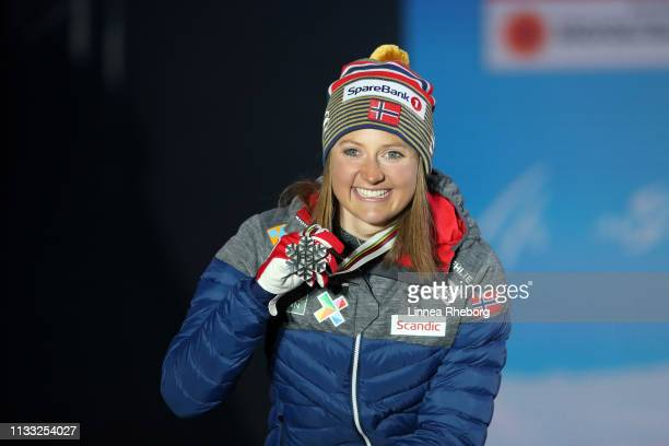 Silver medalist Ingvild Flugstad Oestberg of Norway celebrates with her medal during the Medal Ceremony for the Women's Cross Country 30k race during...