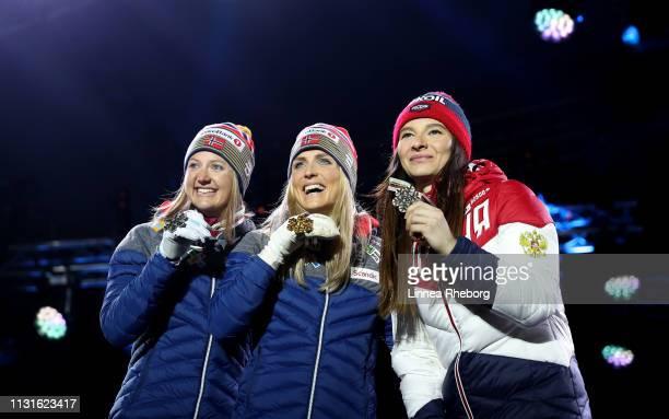 Silver medalist Ingvild Flugstad Oestberg of Norway Gold medalist Therese Johaug of Norway and Bronze medalist Natalia Nepryaeva of Russia celebrate...