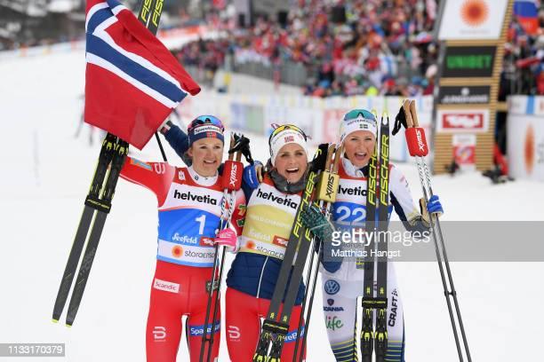 Silver medalist Ingvild Flugstad Oestberg of Norway gold medalist Therese Johaug of Norway and bronze medalist Frida Karlsson of Sweden celebrates...