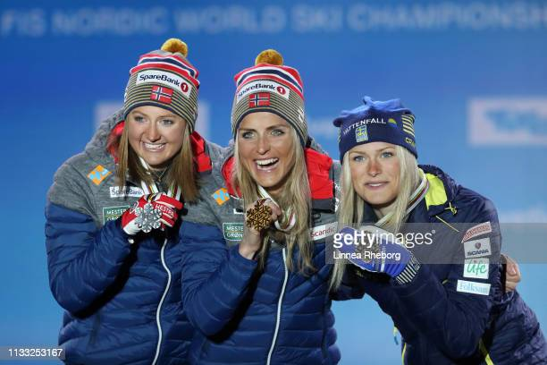 Silver medalist Ingvild Flugstad Oestberg of Norway gold medalist Therese Johaug of Norway and bronze medalist Frida Karlsson of Sweden celebrate...