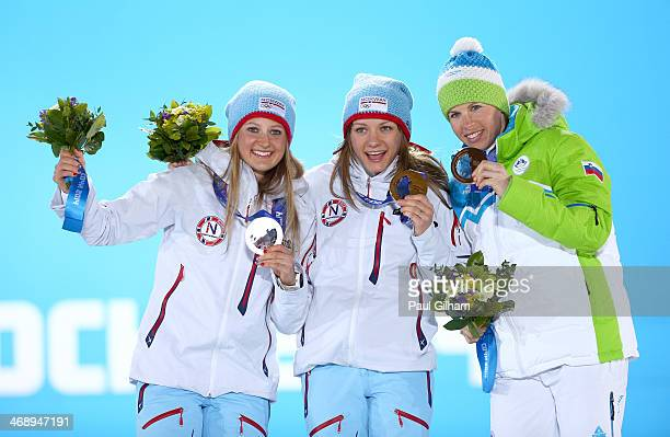 Silver medalist Ingvild Flugstad Oestberg of Norway gold medalist Maiken Caspersen Falla of Norway and bronze medalist Vesna Fabjan of Slovenia...