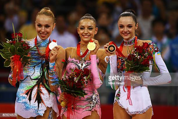 Silver medalist Inna Zhukova gold medalist Evgeniya Kanaeva of Russia and Anna Bessonova of the Ukraine pose with their medals after winning the...