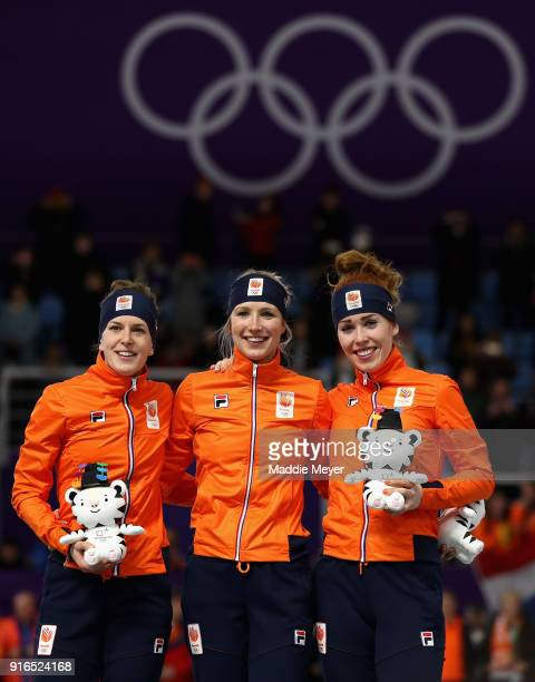 Silver medalist Ireen Wust of the Netherlands gold medalist Carlijn Achtereekte of the Netherlands and bronze medalist Antoinette De Jong of the...