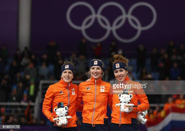 Silver medalist Ireen Wust of the Netherlands gold medalist Carlijn Achtereekte of the Netherlands and bronze medalist Antoinette De Jong of the...