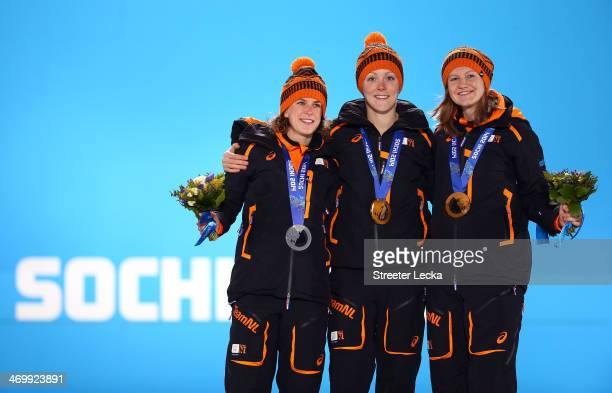 Silver medalist Ireen Wust of the Netherlands gold medalist Jorien ter Mors of the Netherlands and bronze medalist Lotte van Beek of the Netherlands...