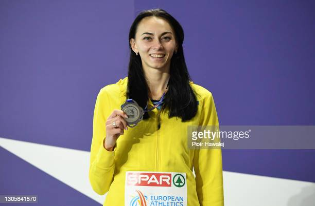 Silver medalist Iryna Heraschenko of Ukraine poses for a photo during the medal ceremony for the Women's High Jump final during the second session on...