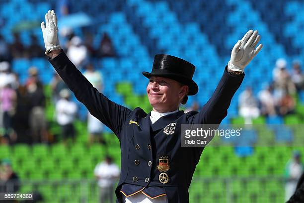 Silver medalist Isabell Werth of Germany riding Weihegold Old celebrates during the medal ceremony of the Dressage Individual Grand Prix Freestyle on...