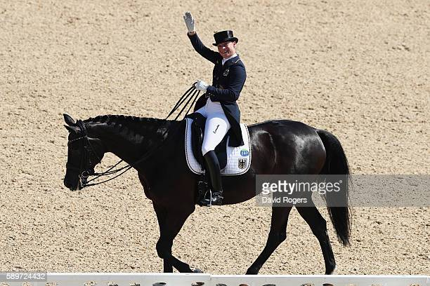 Silver medalist, Isabell Werth of Germany riding Weihegold Old celebrates during Dressage Individual Grand Prix Freestyle on Day 10 of the Rio 2016...