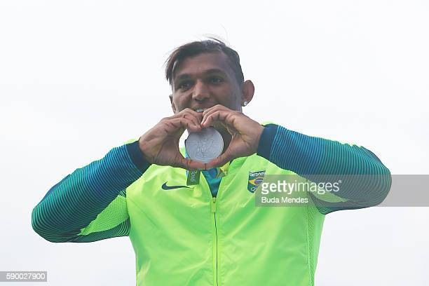 Silver medalist Isaquias Queiroz dos Santos of Brazil celebrates after competing during the Men's Canoe Single 1000m Final A on Day 11 of the Rio...