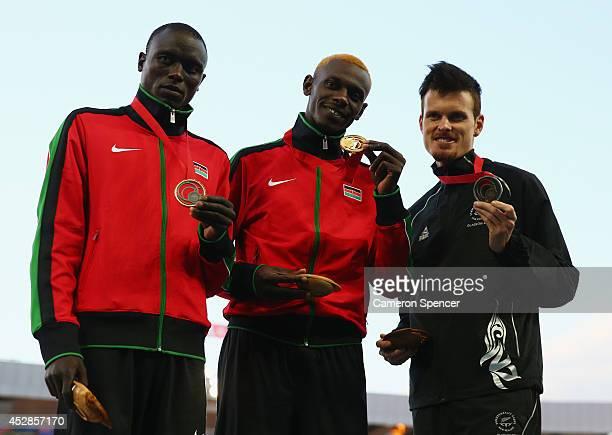 Silver medalist Isiah Kiplangat Koech of Kenya gold medalist Caleb Mwangangi Ndiku of Kenya and bronze medalist Zane Robertson of New Zealand stand...