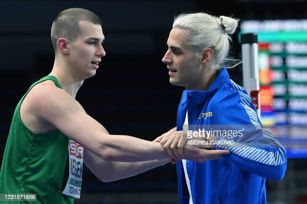 Silver medalist Italy's Gianmarco Tamberi and gold medalist Belarus' Maksim Nedasekau celebrate after the men's high jump final at the 2021 European...