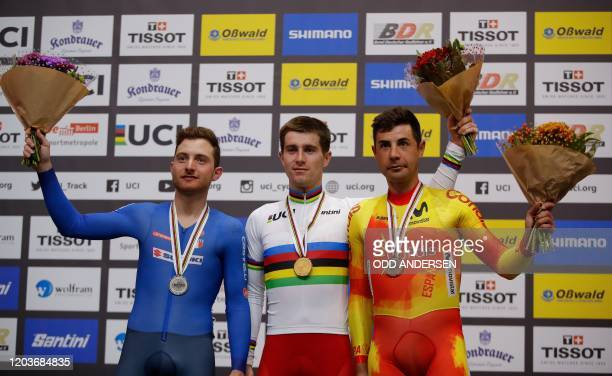 Silver medalist Italy's Simone Consonni, Winner Belarus' Yauheni Karaliok and Bronze medalist Spain's Sebastian Mora Vedri pose on the podium after...
