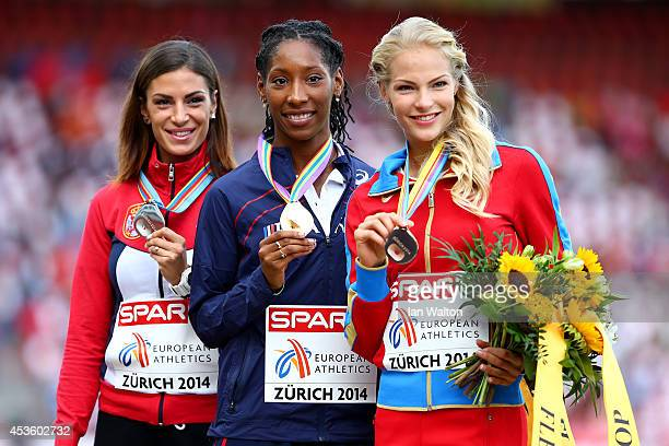 Silver medalist Ivana Spanovic of Serbia, gold medalist Eloyse Lesueur of France and bronze medalist Darya Klishina of Russia stand on the podium...