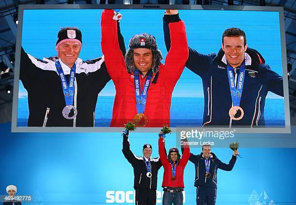 Silver medalist Ivica Kostelic of Crioatia gold medalist Sandro Viletta of Switzerland and bronze medalist Christof Innerhofer of Italy celebrate on...