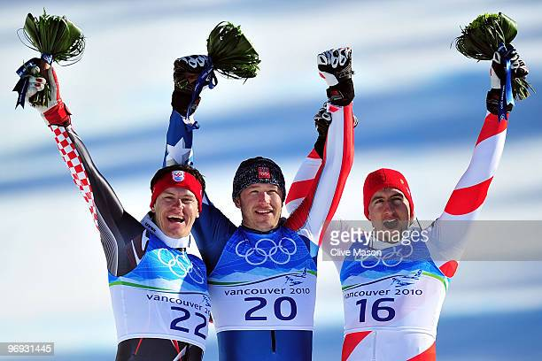 Silver medalist Ivica Kostelic of Croatia, Gold medalist Bode Miller of the United States and Bronze medalist Silvan Zurbriggen of Switzerland...