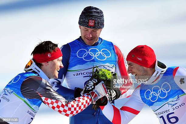 Silver medalist Ivica Kostelic of Croatia Gold medalist Bode Miller of the United States and Bronze medalist Silvan Zurbriggen of Switzerland...