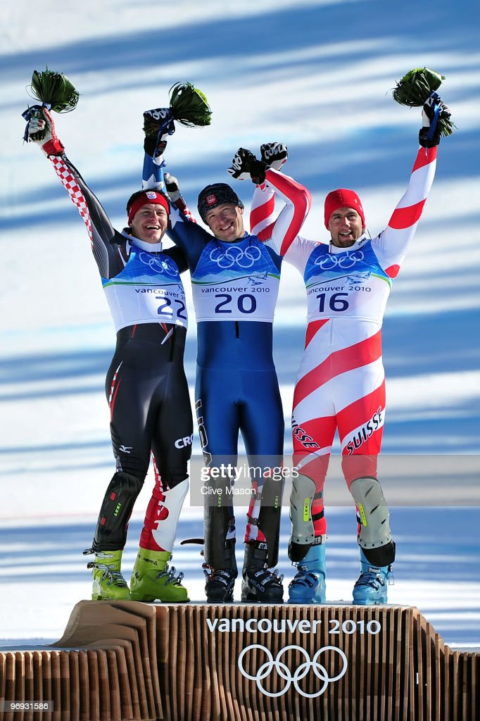 Silver medalist Ivica Kostelic (L) of Croatia, Gold medalist Bode Miller of the United States and Bronze medalist Silvan Zurbriggen (R) of Switzerland celebrate after the Alpine Skiing Men's Super Combined Slalom on day 10 of the Vancouver 2010 Winter Olympics at Whistler Creekside on February 21, 2010 in Whistler, Canada.