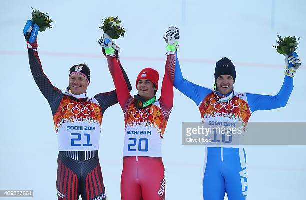 Silver medalist Ivica Kostelic of Croatia gold medalist Sandro Viletta of Switzerland and bronze medalist Christof Innerhofer of Italy celebrate...