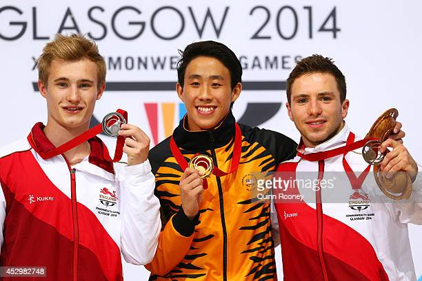 Silver medalist Jack Laugher of England gold medalist Ooi Tze Liang of Malaysia and bronze medalist Oliver Dingley of England pose during the medal...
