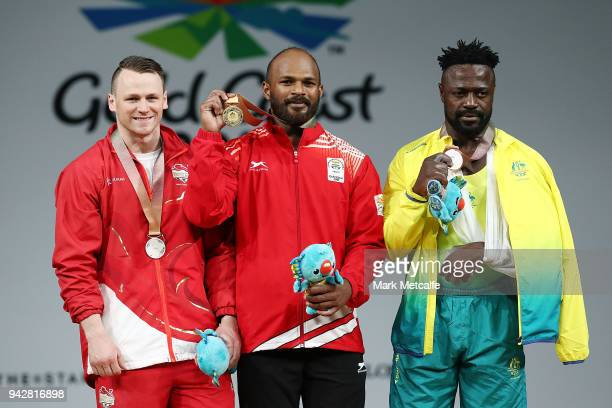 Silver medalist Jack Oliver of England gold medalist Sathish Kumar Sivalingam of India and bronze medalist Francois Etoundi of Australia pose during...