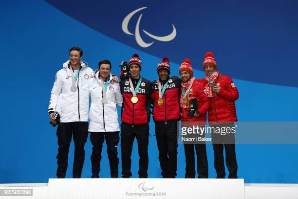 Silver medalist Jake Adicoff of the United States and his guide Sawyer Kesselheim gold medalist Brian McKeever of Canada and his guide Graham...