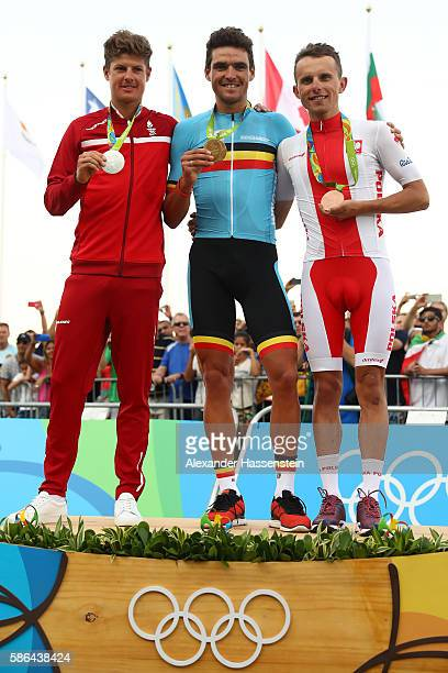 Silver medalist Jakob Fuglsang of Denmark Gold medalist Greg van Avermaet of Belgium and Rafal Majka of Poland celebrates on the podium at the medal...