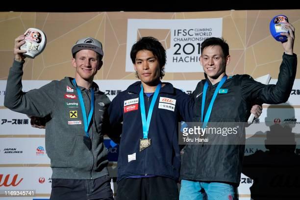 Silver medalist Jakob Schubert of Austria gold medalist Tomoa Narasaki of Japan and bronze medalist Rishat Khaibullin of Kazakhstan celebrate on the...