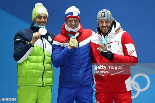 Silver medalist Jakov Fak of Slovenia gold medalist Johannes Thingnes Boe of Norway and bronze medalist Dominik Landertinger of Austria celebrate...