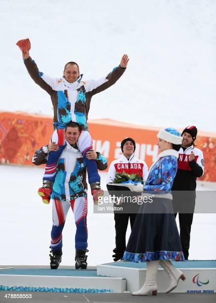 Silver medalist Jakub Krako of Slovakia and guide Martin Motyka celebrate during the medal ceremony for the Men's Giant Slalom Visually Impaired on...