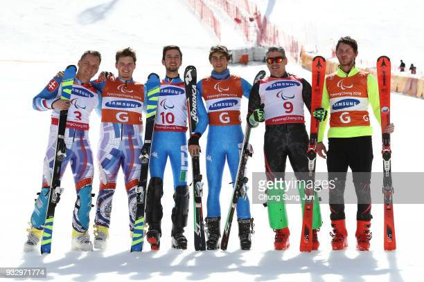 Silver medalist Jakub Krako of Slovakia Gold medalist Giacomo Bertagnolli of Italy and Bronze medalist Mac Marcoux of Canada pose during the victory...