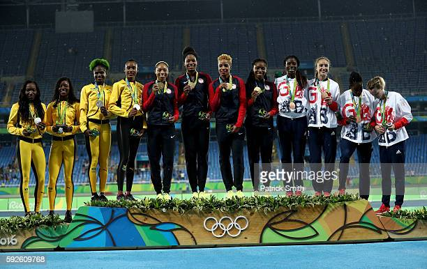 Silver Medalist Jamaica gold medalists the United States and bronze medalists Great Britain stand on the podium during the medal ceremony for the...