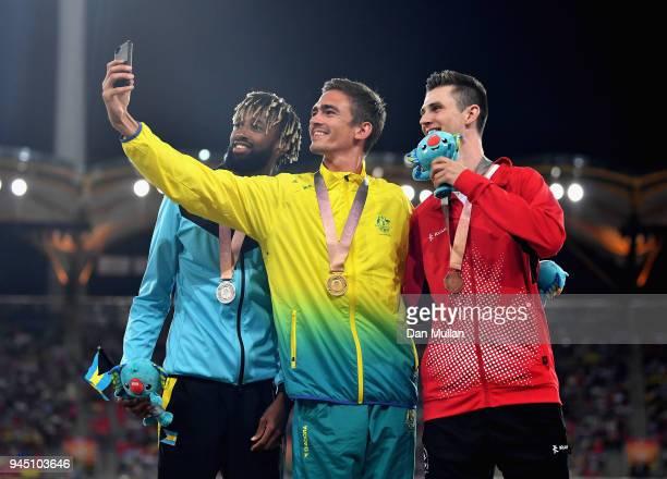 Silver medalist Jamal Wilson of the Bahamas gold medalist Brandon Starc of Australia and bronze medallist Django Lovett of Canada pose for a selfie...