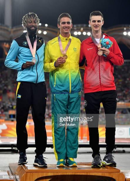 Silver medalist Jamal Wilson of the Bahamas gold medalist Brandon Starc of Australia and bronze medallist Django Lovett of Canada celebrate during...