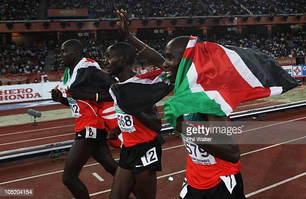 Silver medalist James Magut of Kenya, Gideon Gathimba of Kenya and gold medalist Silas Kiplagat of Kenya celebrate after the Men's 1500 Metres Final...