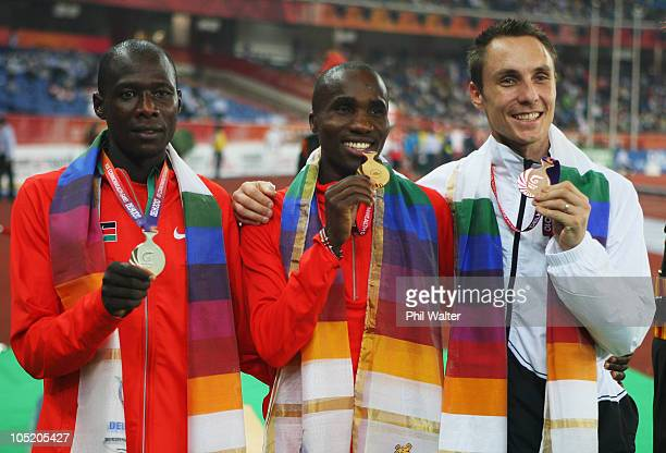 Silver medalist James Magut of Kenya, gold medalist Silas Kiplagat of Kenya and bronze medalist Nick Willis of New Zealand celebrate on the podium...
