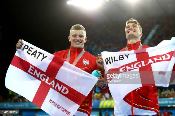 Silver medalist James Wilby of England and gold medalist Adam Peaty of England pose during the medal ceremony for the Men's 100m Breaststroke Final...