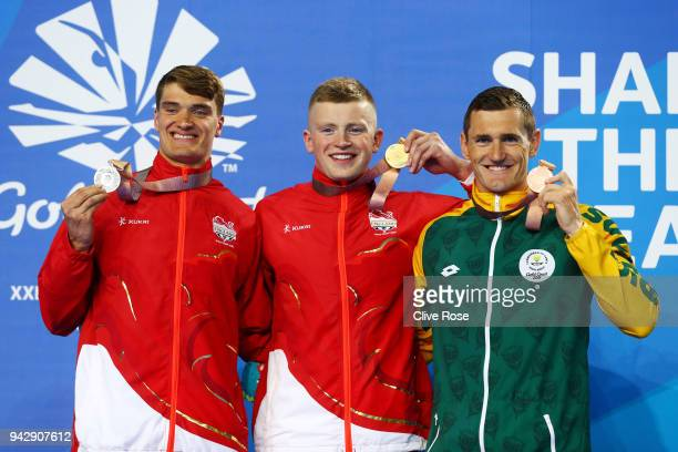 Silver medalist James Wilby of England gold medalist Adam Peaty of England and Bronze medalist Cameron van der Burgh of South Africa pose during the...